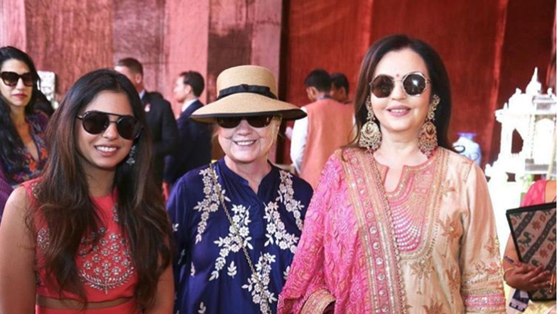Hillary Clinton posing with bride Isha Ambani and mother-of-the-bride Nita Ambani. Huma Abedine is seen in the background.