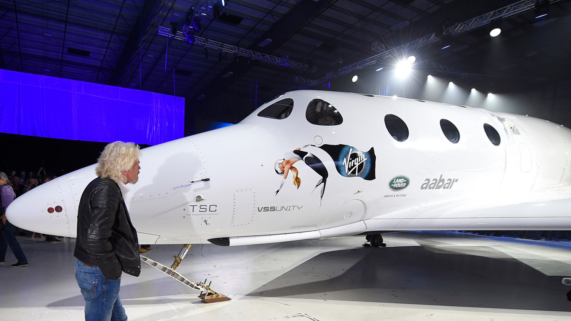 "Sir Richard Branson walks in front of Virgin Galactic's SpaceShipTwo space rocket after its unveiling on Friday, February 1<div class=""e3lan e3lan-in-post1""><script async src=""//pagead2.googlesyndication.com/pagead/js/adsbygoogle.js""></script>