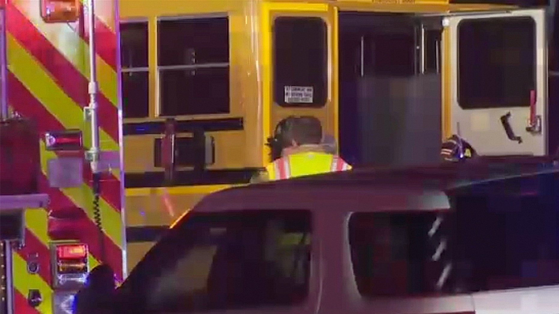 Two people have died following a collision Wednesday night between a truck heading the wrong way and a school bus, officials say.