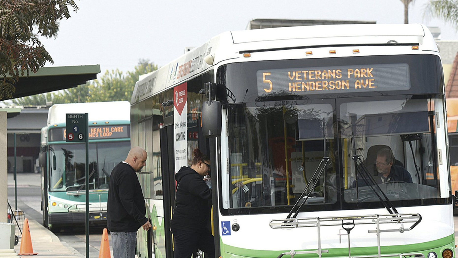 In this file photo, commuters ride a new zero emissions electric bus in California.