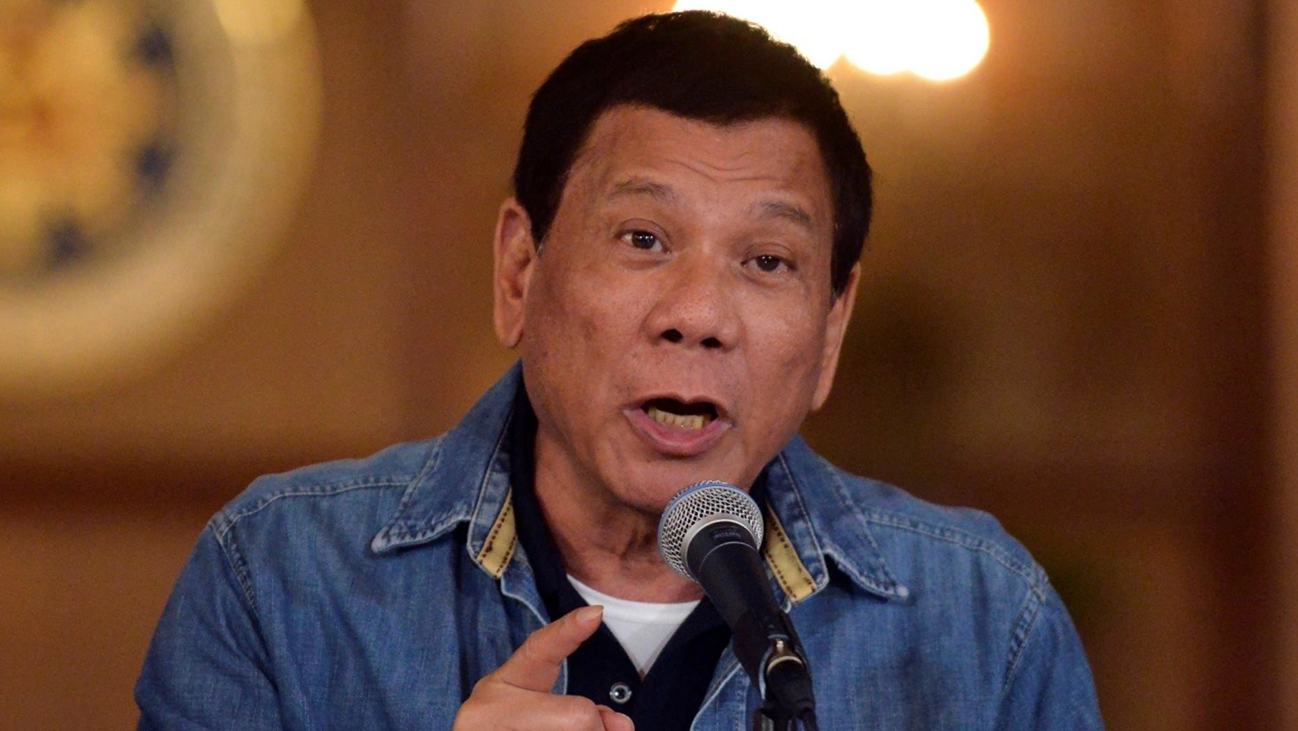 Philippine President Rodrigo Duterte gestures while speaking during a late-night news conference at the presidential palace in Manila, Philippines.