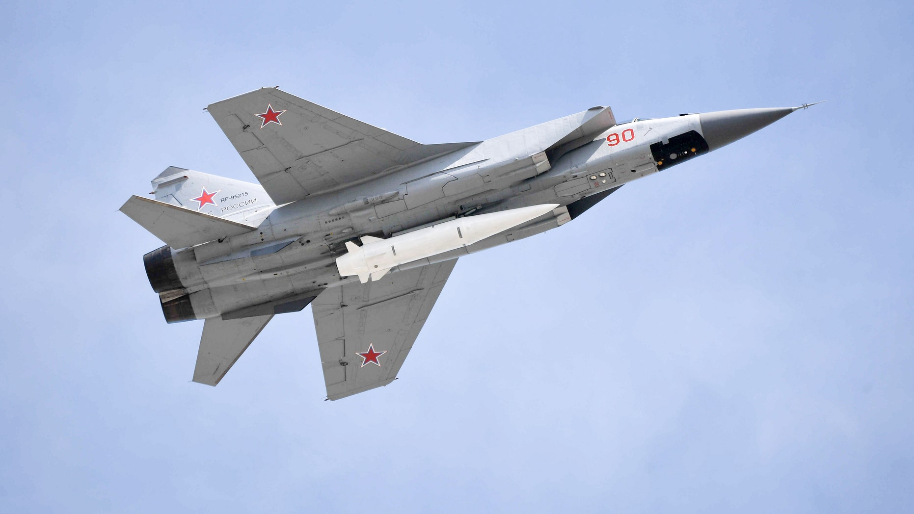 Mikoyan MiG-31K fighter jet with Kinzhal hypersonic missiles flies over Moscow's Red Square marking the 73rd anniversary of the victory over Nazi Germany in World War II.