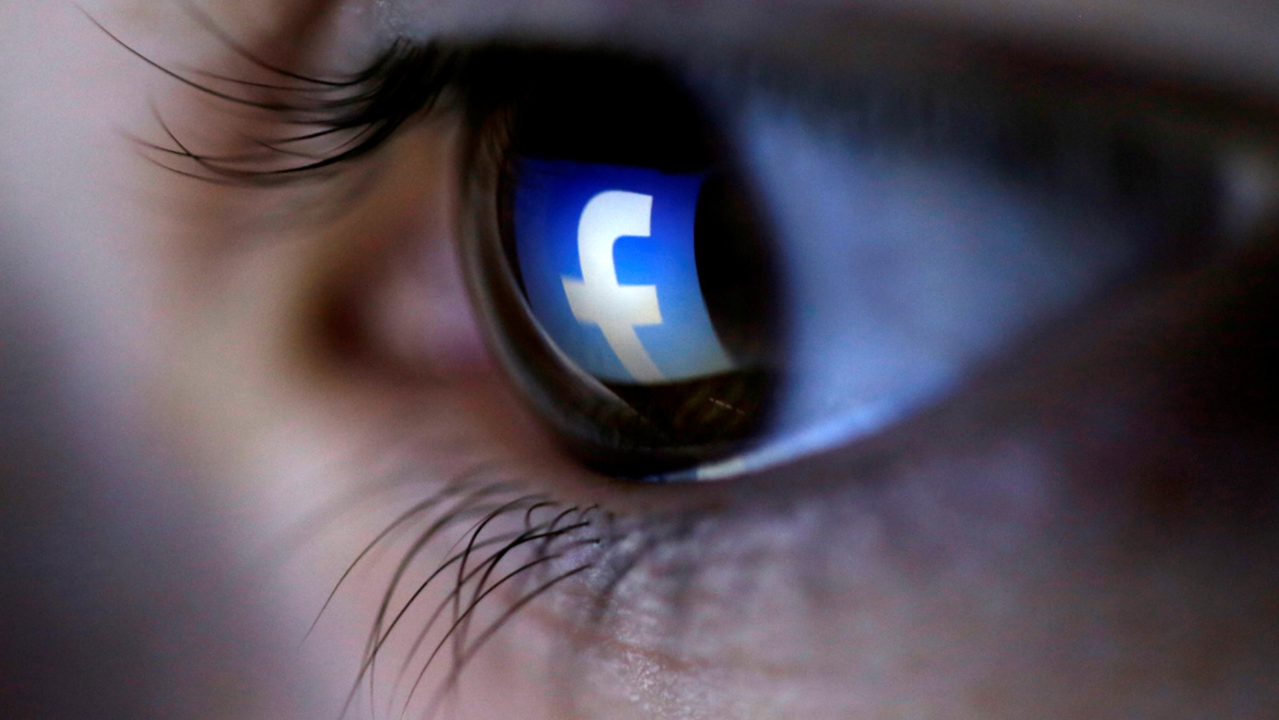 FILE PHOTO: A picture illustration shows a Facebook logo reflected in a person's eye, in Zenica, March 13, 2015. REUTERS/Dado Ruvic/Illustration