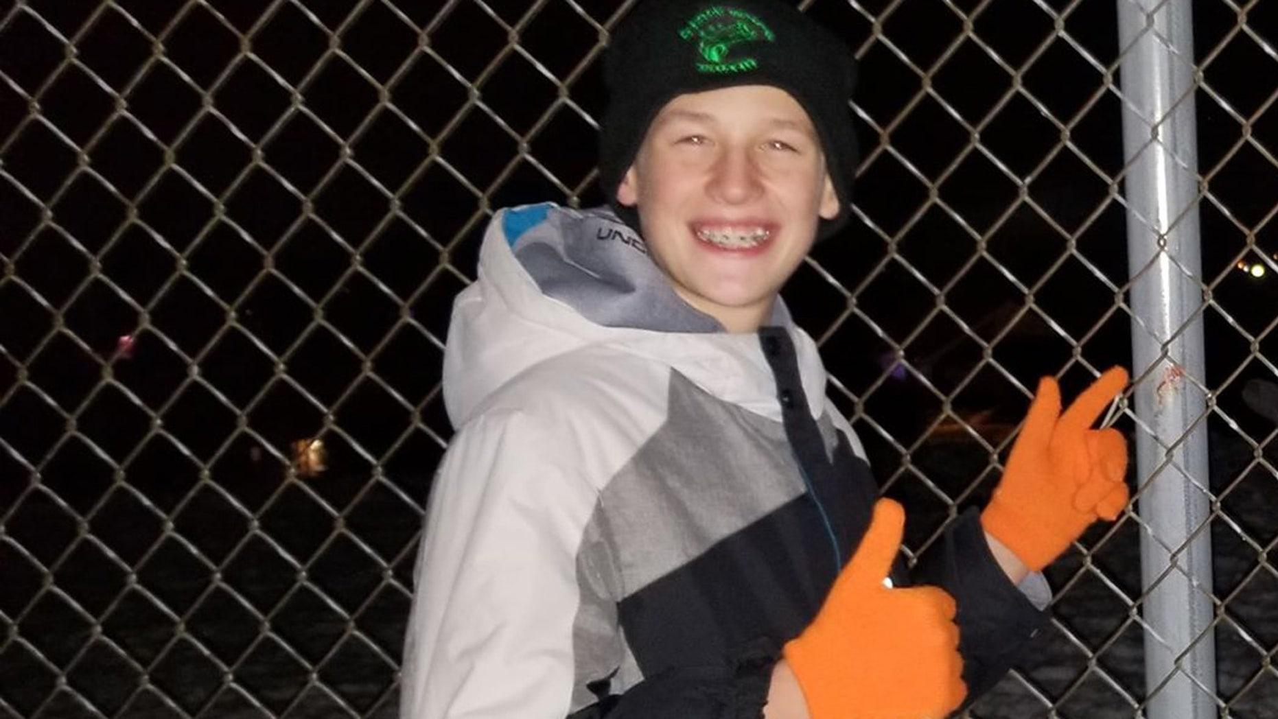 Spencer Kline, 11, poses next to where he got his tongue stuck to a cold pole.