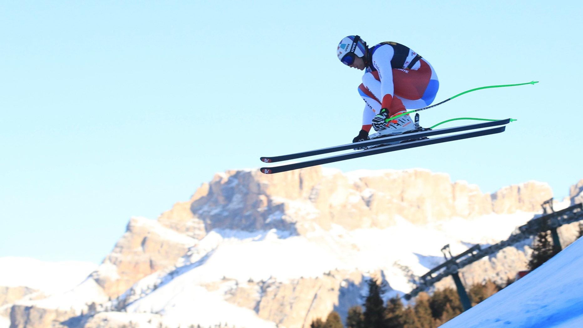 Switzerland's Marc Gisin speeds down the course during a men's World Cup downhill, in Val Gardena, Italy, Saturday, Dec. 15, 2018.