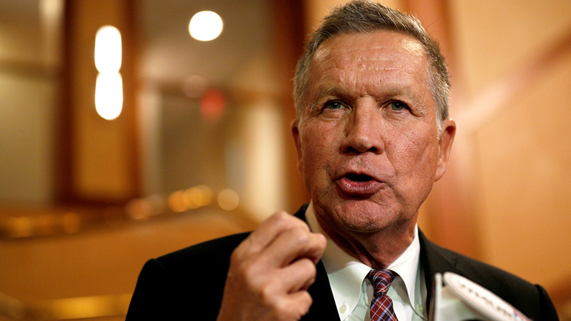 Ohio Governor and former presidential candidate John Kasich speaks to the press in Concord, New Hampshire, U.S., November 15, 2018.