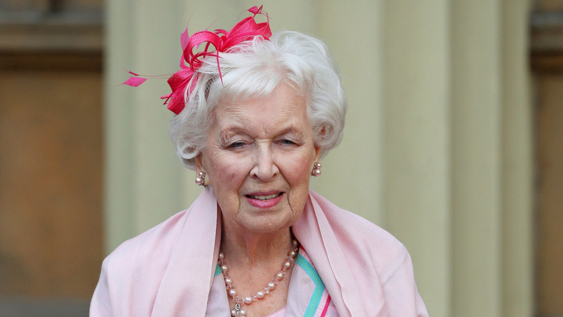 "FILE - Nov. 16, 2017 file photo of Dame June Whitfield after she was made a dame. British actress and comedic star June Whitfield, whose long career included memorable roles in TV series ""Absolutely Fabulous"" and ""Terry and June,"" has died. She was 93. (Jonathan Brady/PA Wire/PA via AP, File)"