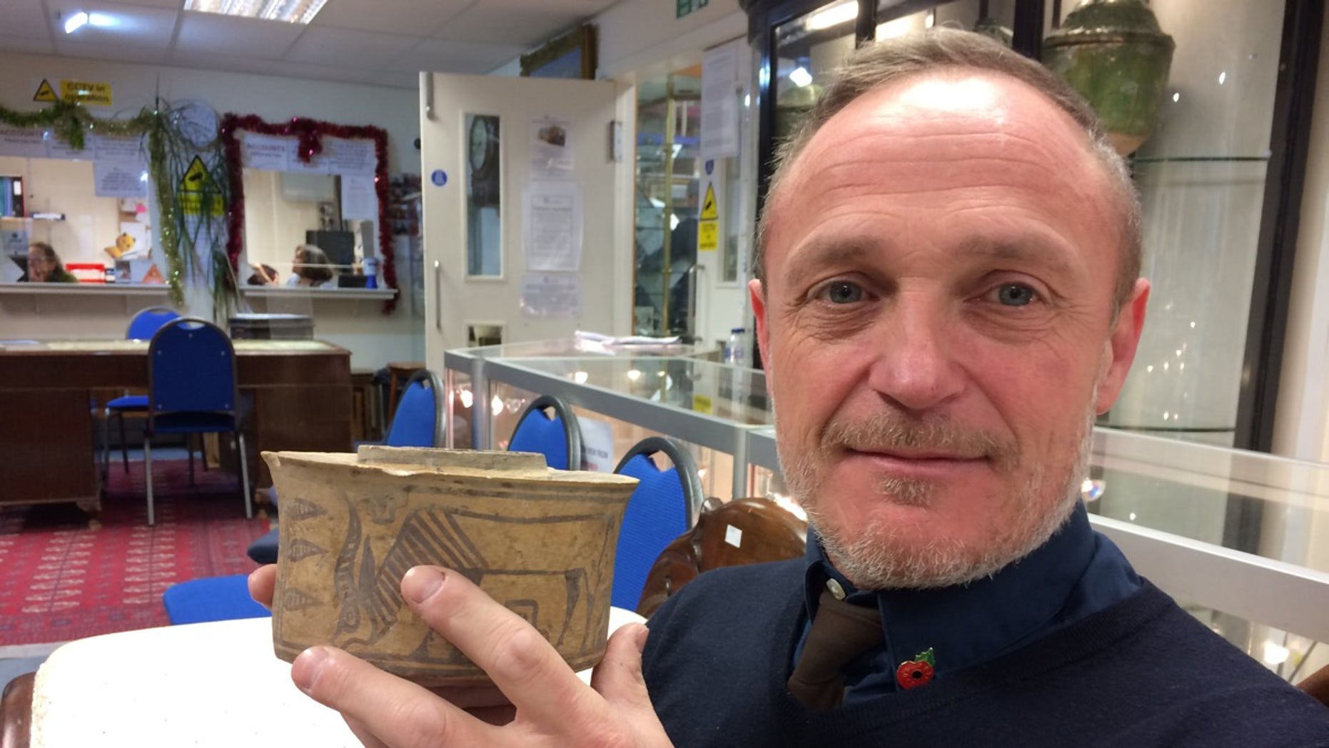 Who knew? This pottery jar being sold at a flea market was made about 2,000 years before the birth of Christ.