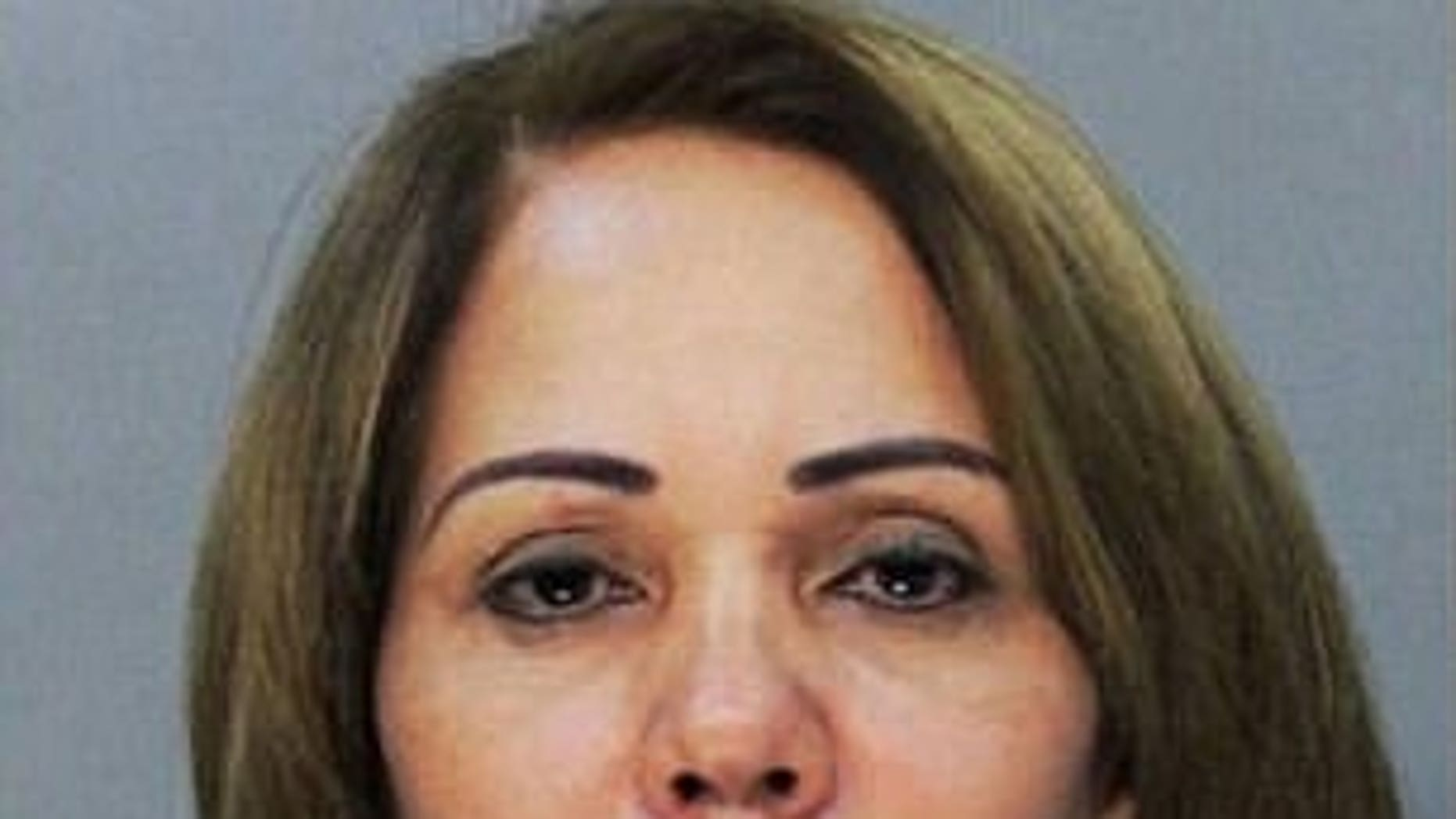 A lawsuit filed by Fior Pichardo de Veloz, in tie with her 2013 arrest, might proceed, a decider ruled final week. (Miami-Dade County Corrections Department)