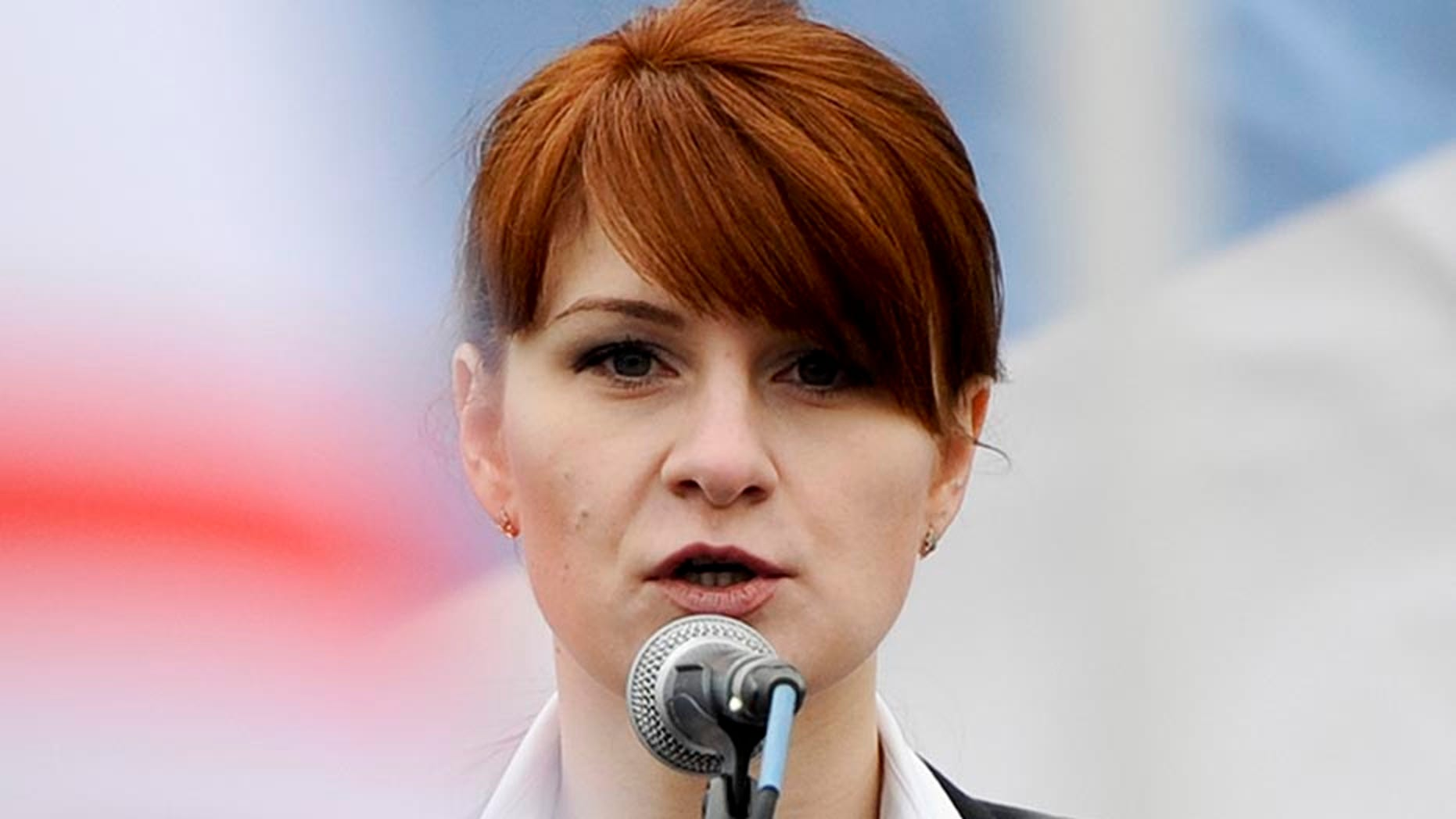 Maria Butina, in 2013, speaks to a crowd during a rally in support of legalizing the possession of handguns in Moscow, Russia.