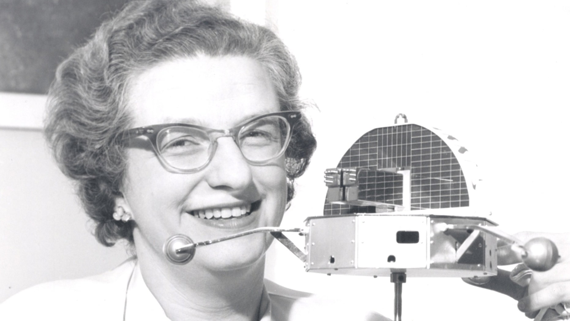 Dr. Nancy Grace Roman is shown with a model of the Orbiting Solar Observatory in 1962. She died on Christmas Day