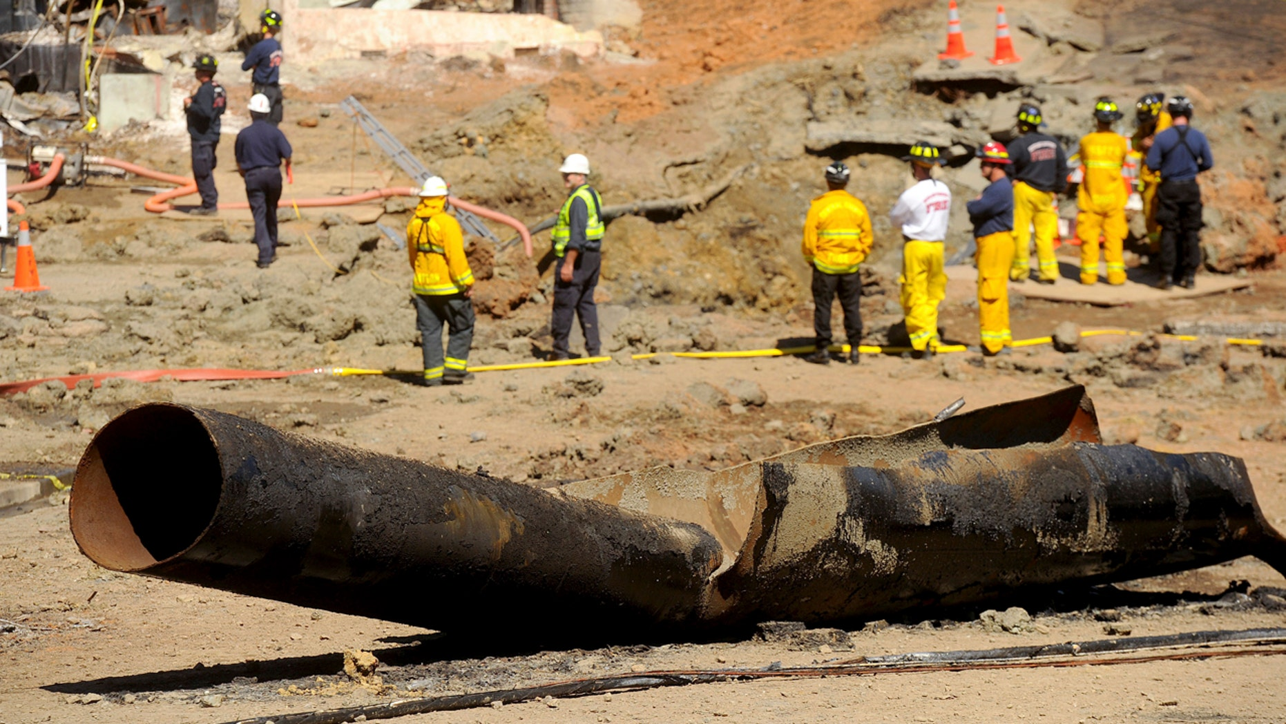 In this Sept. 11, 2010, file photo, a natural gas line lies broken on a San Bruno, Calif., road after a massive explosion. The California Public Utilities Commission said Friday, Dec. 14, 2018, that an investigation by its staff found Pacific Gas & Electric Co. lacked enough employees to fulfill requests to find and mark natural gas pipelines(AP Photo/Noah Berger, File)