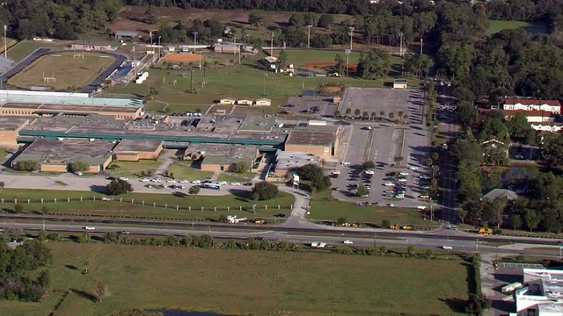 A Hillsborough County sheriff's deputy killed three family members before he killed himself near a Florida high school on Wednesday, police said.