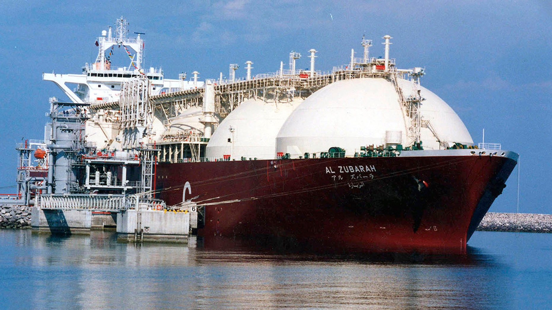This undated file photo shows a Qatari liquid natural gas (LNG) tanker ship being loaded up with LNG at Raslaffans Sea Port, northern Qatar. (AP Photo, File)