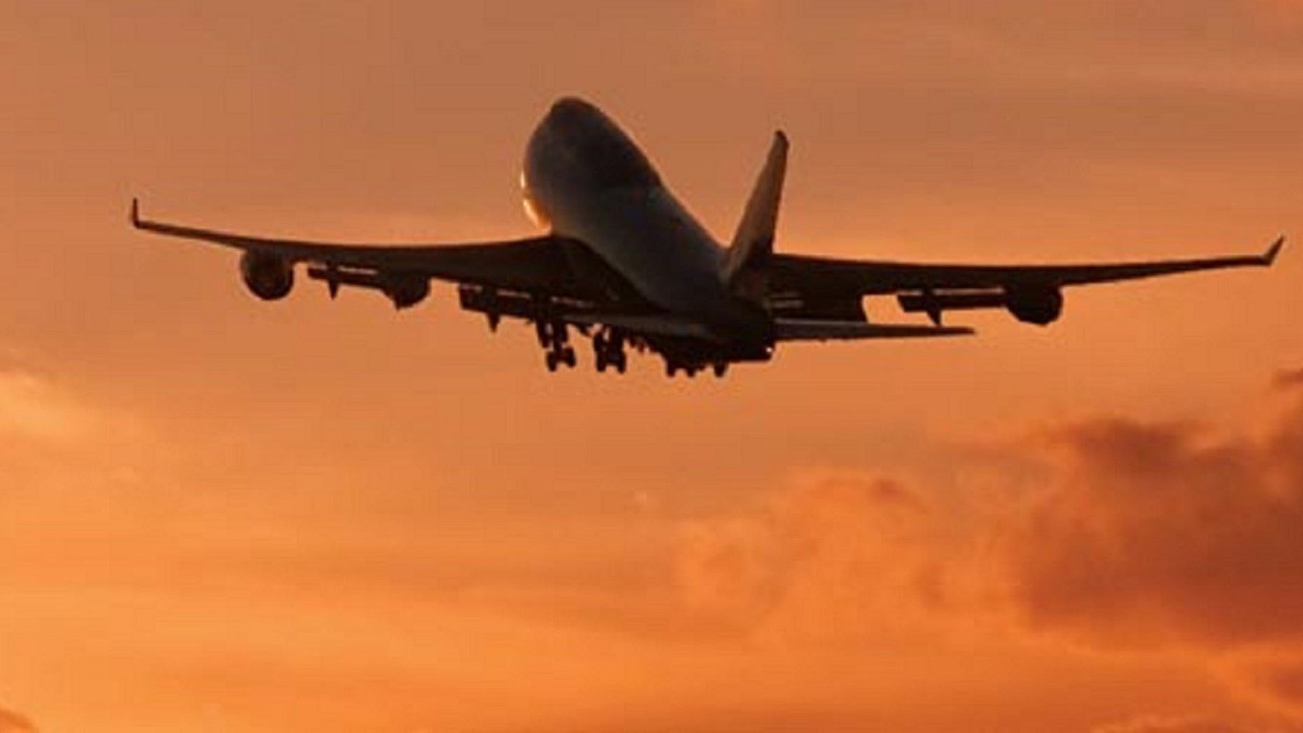 FILE: Airplane flying into the sunset. A father accompanied her daughter over the Christmas holiday to ensure he could spend time with her.