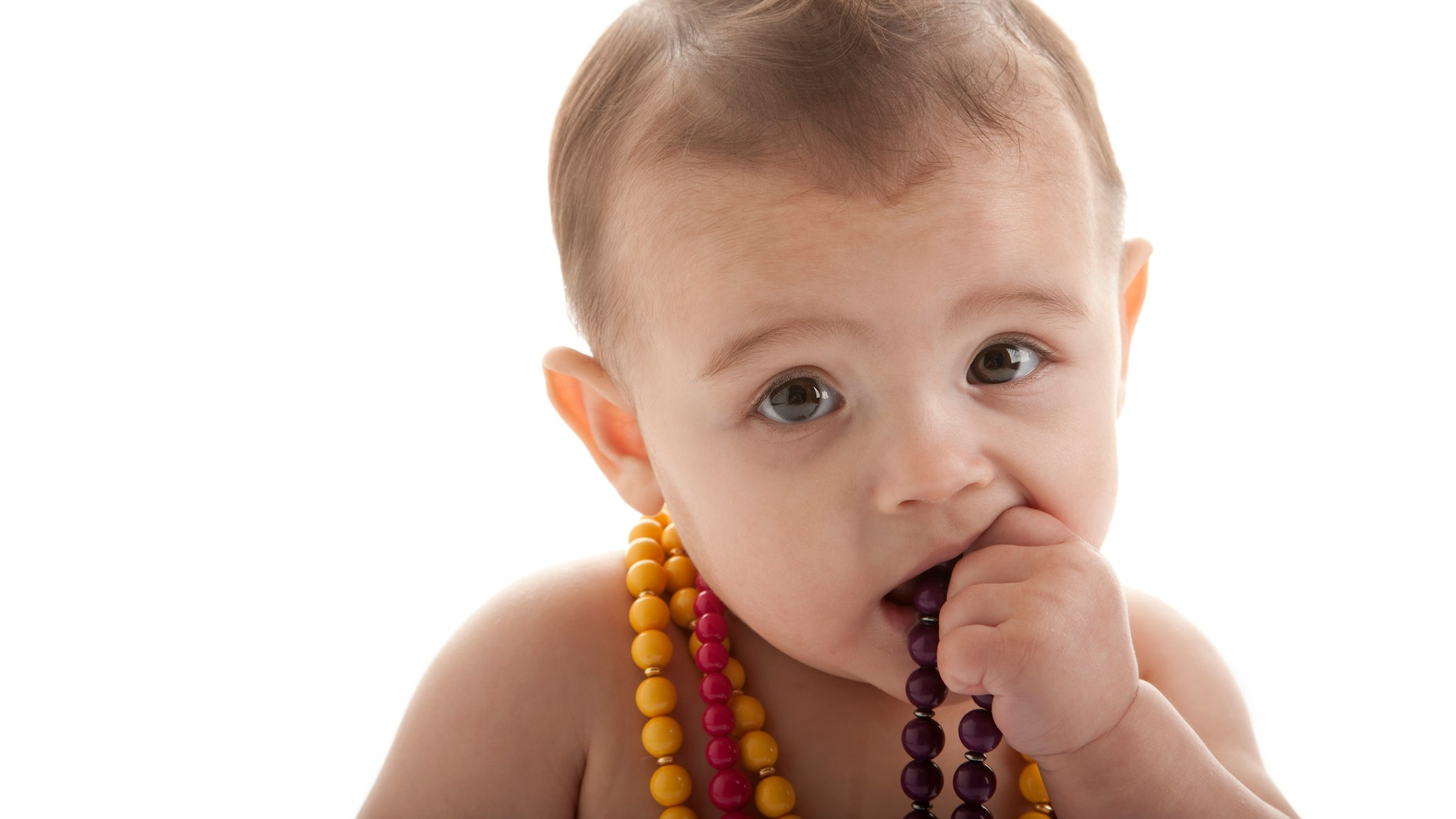 """The FDA said it received a report of an 18-month-old who was strangled to death by an amber teething necklace during a nap, and another concerning a 7-month-old who choked on the beads of a wooden teething bracelet while under parental supervision.<br data-cke-eol=""""1"""">"""