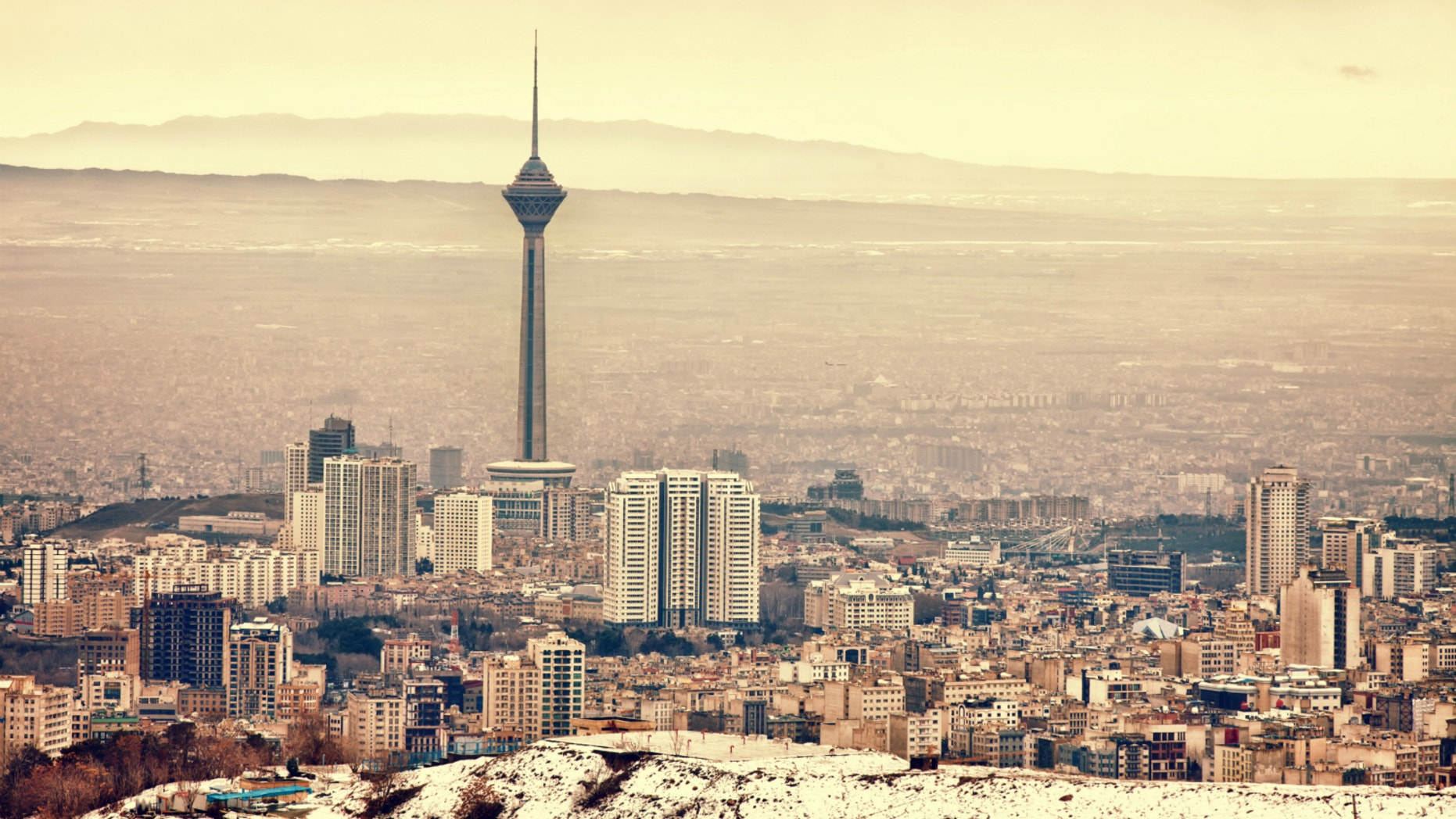 As groundwater drains from rock under Tehran, the city is paying a steep price.