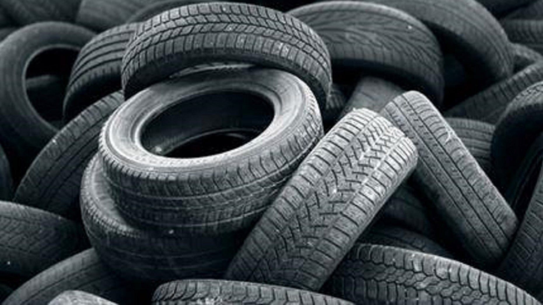 FILE: A stockpile of tires. A Houstonwoman's car windshield was smashed when a tire flew and hit her vehicle on Thursday morning.