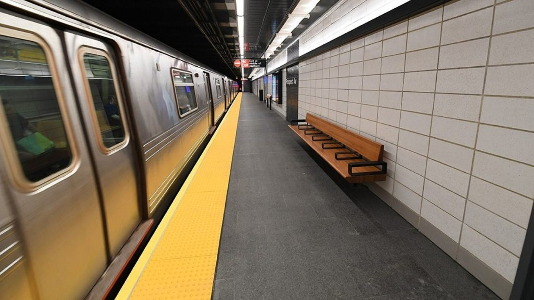 A subway rider allegedly kicked a passenger on a Brooklyn, N.Y., subway train and hurled a racial slur at the woman.