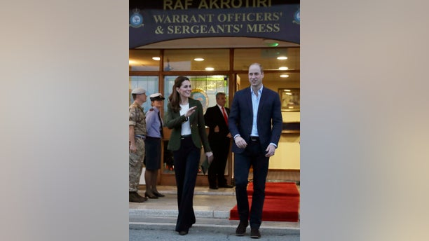 Britain's Prince William, right, and his wife Kate, the Duchess of Cambridge, stand outside the mess hall at the Akrotiri Royal Air Force base, near the south coastal city of Limassol, Cyprus, Wednesday, Dec. 5, 2018.