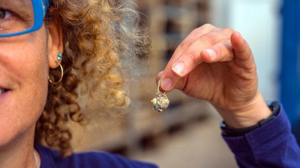 The Gold earring discovered at Caesarea. (Photo: Yaniv Berman, courtesy of the Caesarea Development Corporation)