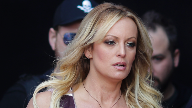 """FILE - In this Oct. 11, 2018, file photo, adult film actress Stormy Daniels arrives for the opening of the adult entertainment fair """"Venus,"""" in Berlin. Attorneys for President Trump want a Los Angeles judge to award $340,000 in legal fees for successfully defending him against defamation claims by Daniels. Attorneys are due in Los Angeles federal court Monday, Dec. 3, to make their case that gamesmanship by Daniels' lawyer led to big bills. (AP Photo/Markus Schreiber, File)"""