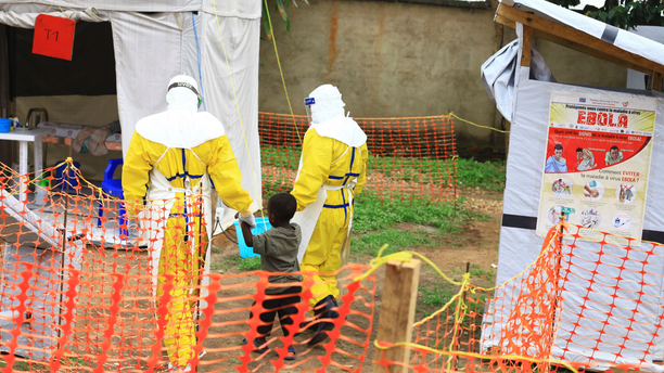 Health workers walk with a boy suspected as having the Ebola virus in Beni, Eastern Congo, in this file photo dated Sept. 9, 2018.