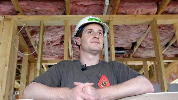 Democratic congressional candidate Dan McCready leans against wallboard as he pauses during a Habitat For Humanity building event in Charlotte, N.C.