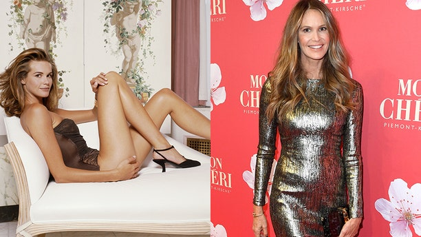 """Elle Macpherson, nicknamed """"The Body"""" for her statuesque features, posed on the red carpet while attending the Mon Cheri Barbara Day event in the old Bayerische Staatsbank."""