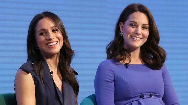 Meghan Markle with Kate Middleton.