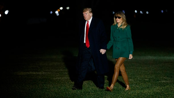 President Donald Trump and first lady Melania Trump arrive on the South Lawn of the White House after making a surprise visit to troops in Iraq, Thursday, Dec. 27, 2018, in Washington. (AP Photo/Evan Vucci)