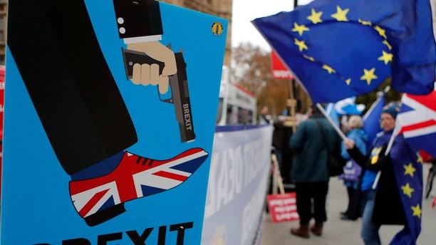 Protestors demonstrate opposite Parliament against Britain's Brexit split from Europe, in London, Thursday, Dec. 6, 2018.