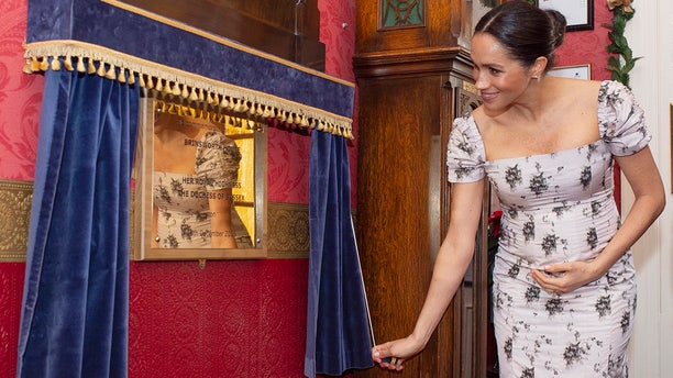 Meghan, the Duchess of Sussex visits the Royal Variety Charity's residential nursing and care home Brinsworth House, in Twickenham, south west London, Tuesday, Dec. 18, 2018. The Royal Variety Charity assists those who have worked professionally in the entertainment industry and are in need of help and assistance as a result of old age, ill-health, or hard times. (Geoff Pugh/Pool via AP)