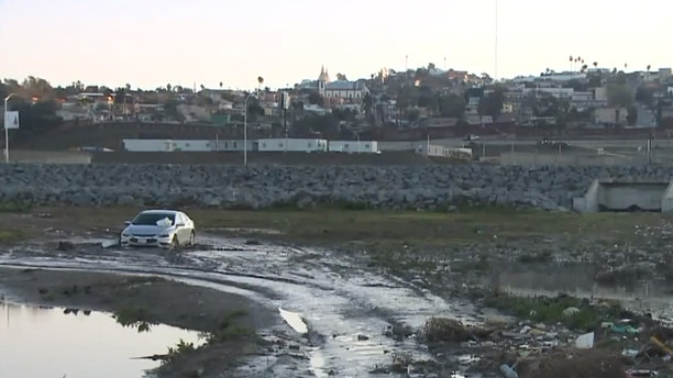 The Tijuana River Valley is littered with various debris, including this car.