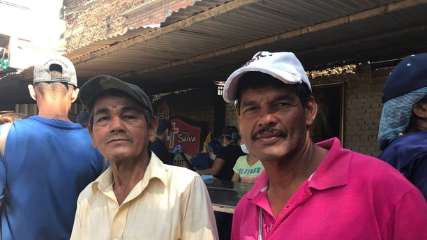 """""""Crimes are committed by police, a lot of the criminals are police themselves,"""" Saul Moros, 59, from the Venezuelan city of Valencia. (left) Luis Farias, 48, said gun violence was bad when guns were freely available – but became much worse after the so-called prohibition."""