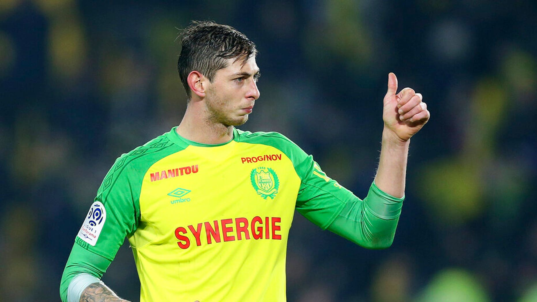 In this his picture taken on Jan. 14, 2018, Argentine soccer player, Emiliano Sala, of the FC Nantes club, western France, gives a thumbs up during a soccer match against PSG in Nantes, France.