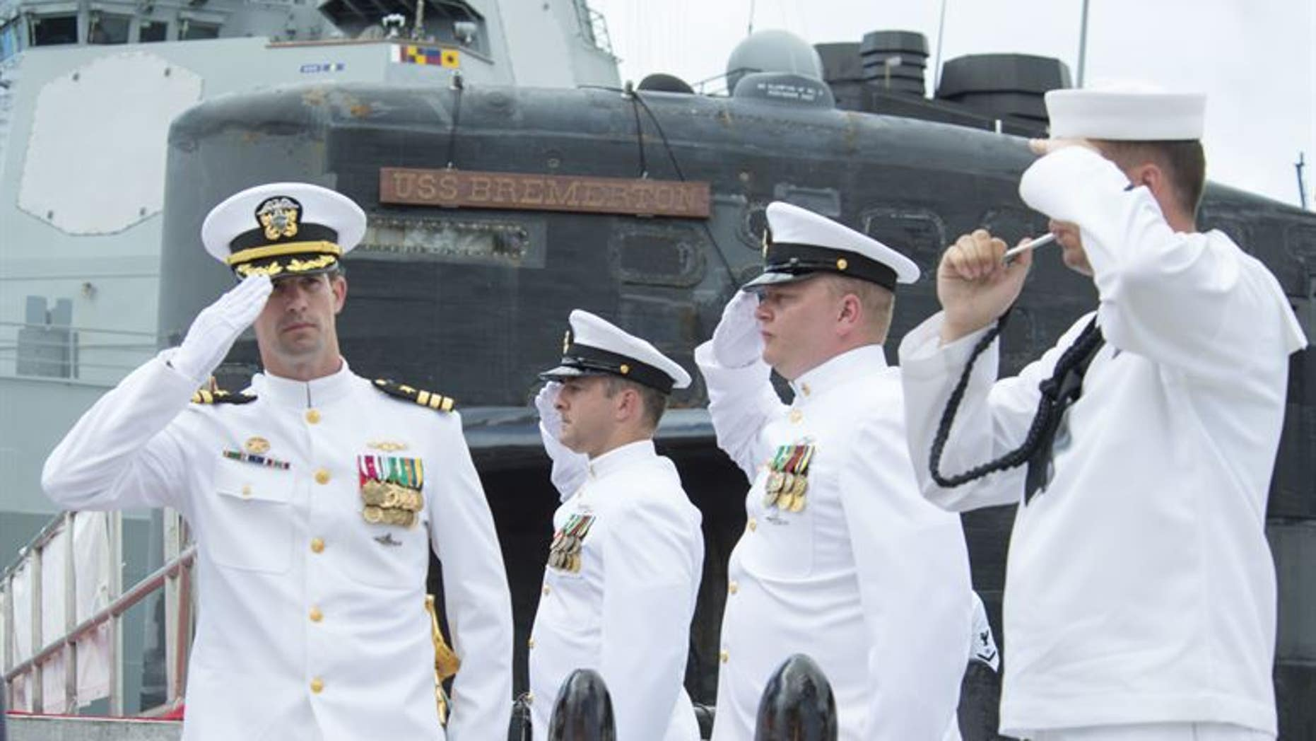 Cmdr. Travis W. Zettel (left), commanding officer of the Los Angeles-class fast-attack submarine USS Bremerton (SSN 698), salutes sideboys during a change of command ceremony on Joint Base Pearl Harbor-Hickam.