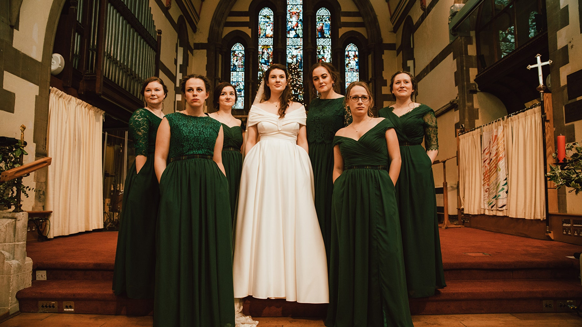 One savvy bride made sure her bridesmaids looked – and felt – their best on her wedding day, outfitting her six pals in bespoke, floor-length gowns complete with practical pockets.