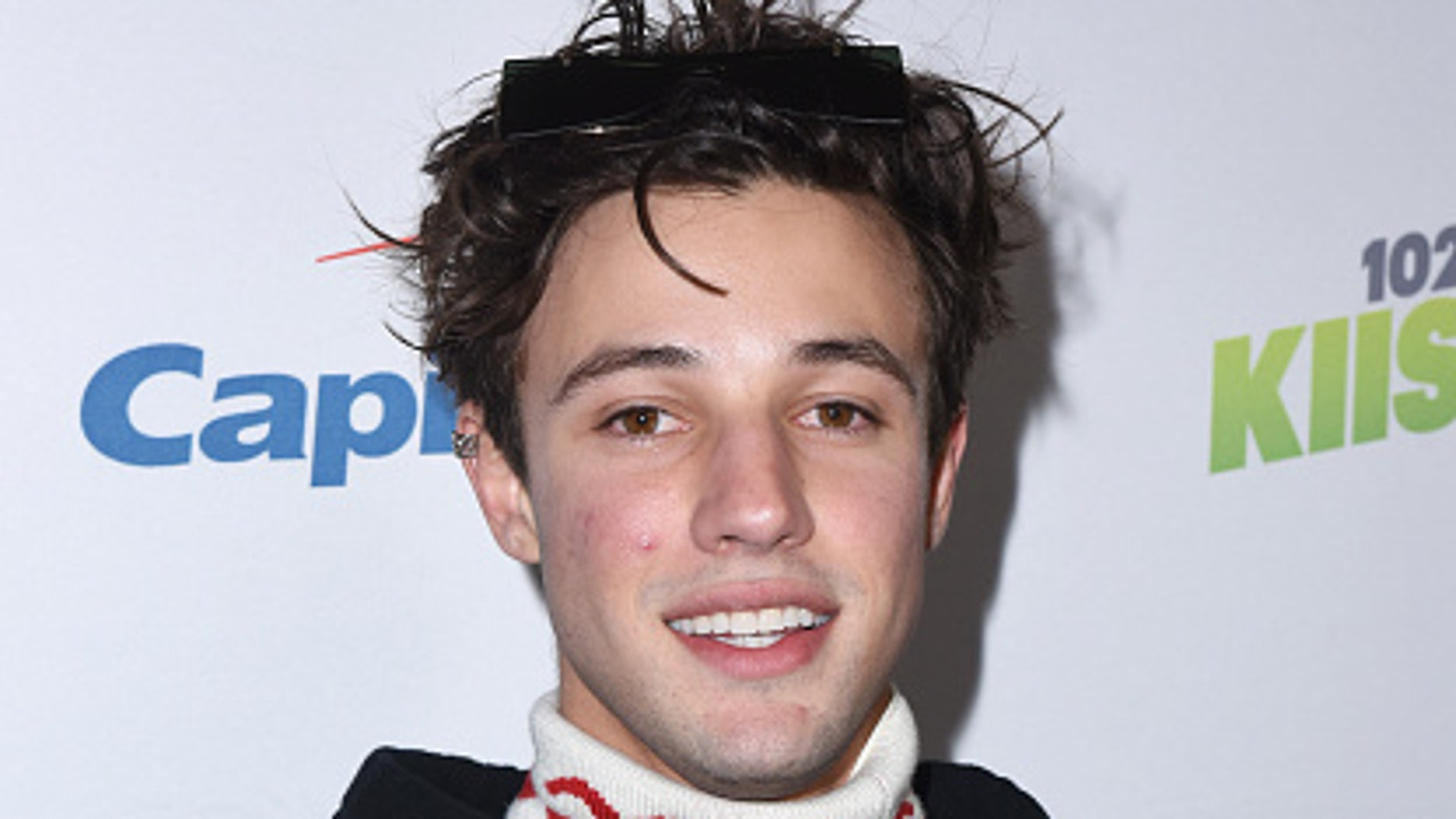Cameron Dallas, 24, was arrested Saturday for allegedly punching a man in the face. (Getty Images)