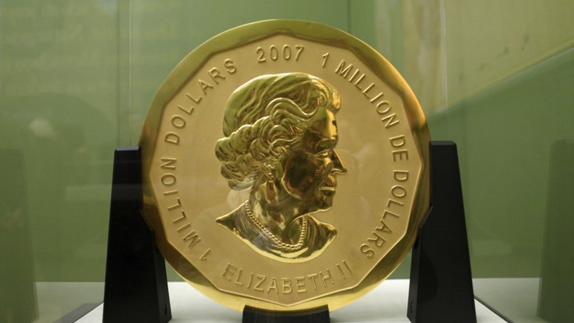 The Dec. 12, 2010 file photo shows the gold coin 'Big Maple Leaf' in the Bode Museum in Berlin. Four young men have gone on trial over the brazen theft of a 221-pound Canadian gold coin from a Berlin museum.