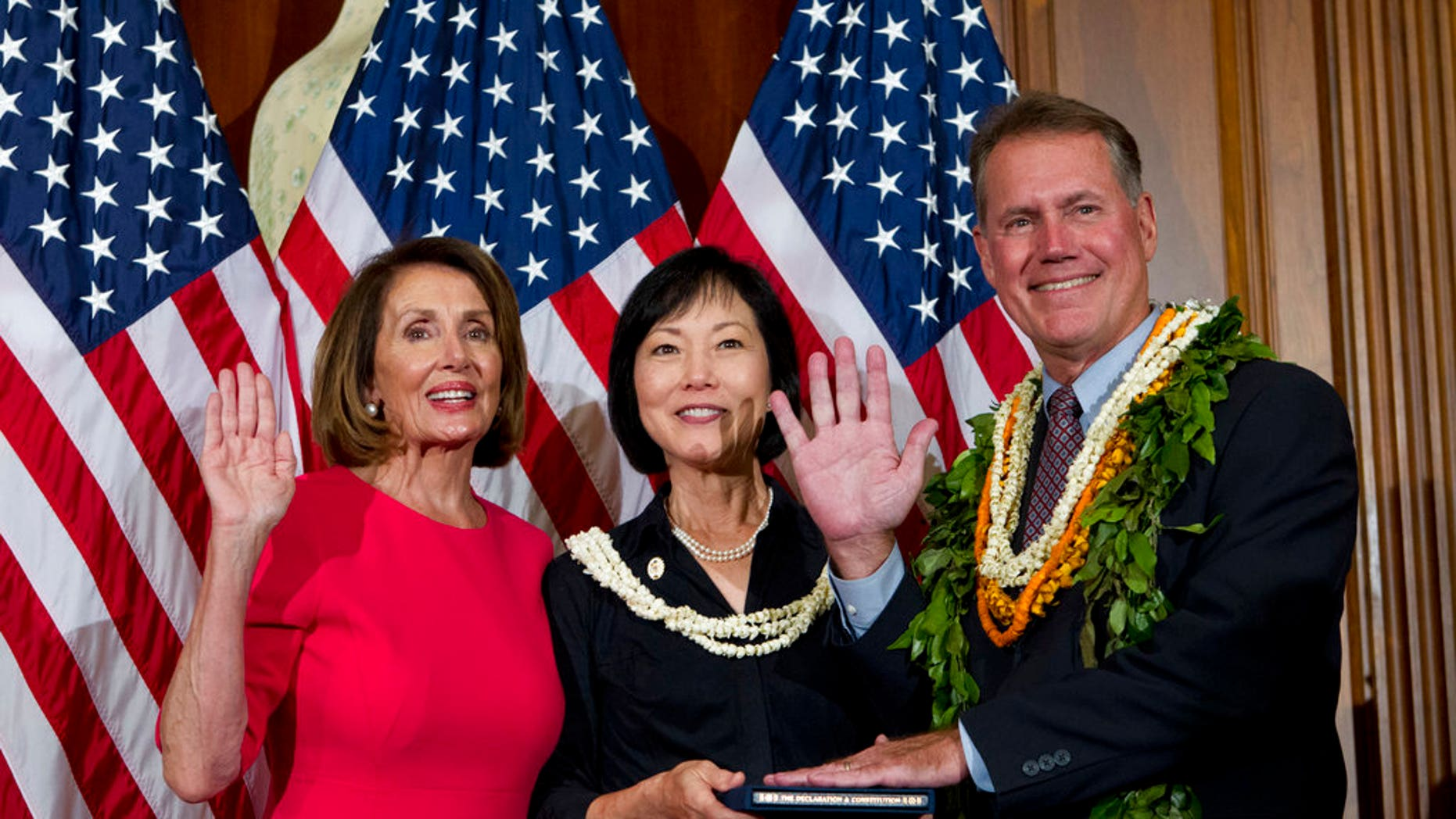 """House Speaker Nancy Pelosi of California administers the oath of office to Rep. Ed Case, D-Hawaii, during ceremonial swearing-in on Capitol Hillon Jan. 3. Case attracted criticism this week for saying he feels like an """"Asian"""" trapped in a white man's body. (AP Photo/Jose Luis Magana)"""