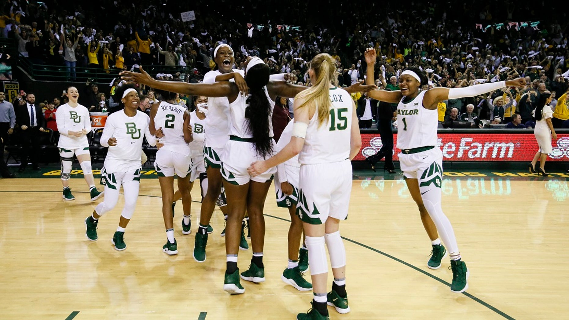 Baylor players celebrate after a 68-57 victory over No. 1 Connecticut in an NCAA college basketball game Thursday, Jan. 3, 2019, in Waco, Texas. (AP Photo/Ray Carlin)