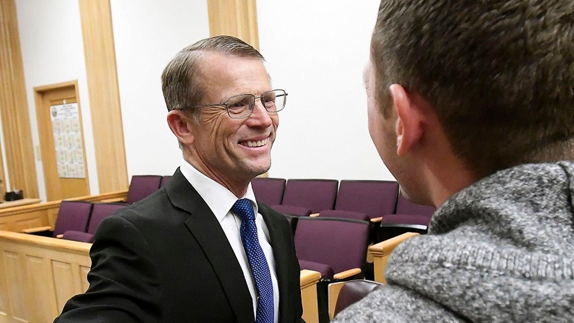 Robert Crosland smiles at son Mario Crosland after Robert was found not guilty of misdemeanor animal cruelty, Friday, Jan. 4, 2019, in Preston, Idaho. (Associated Press)