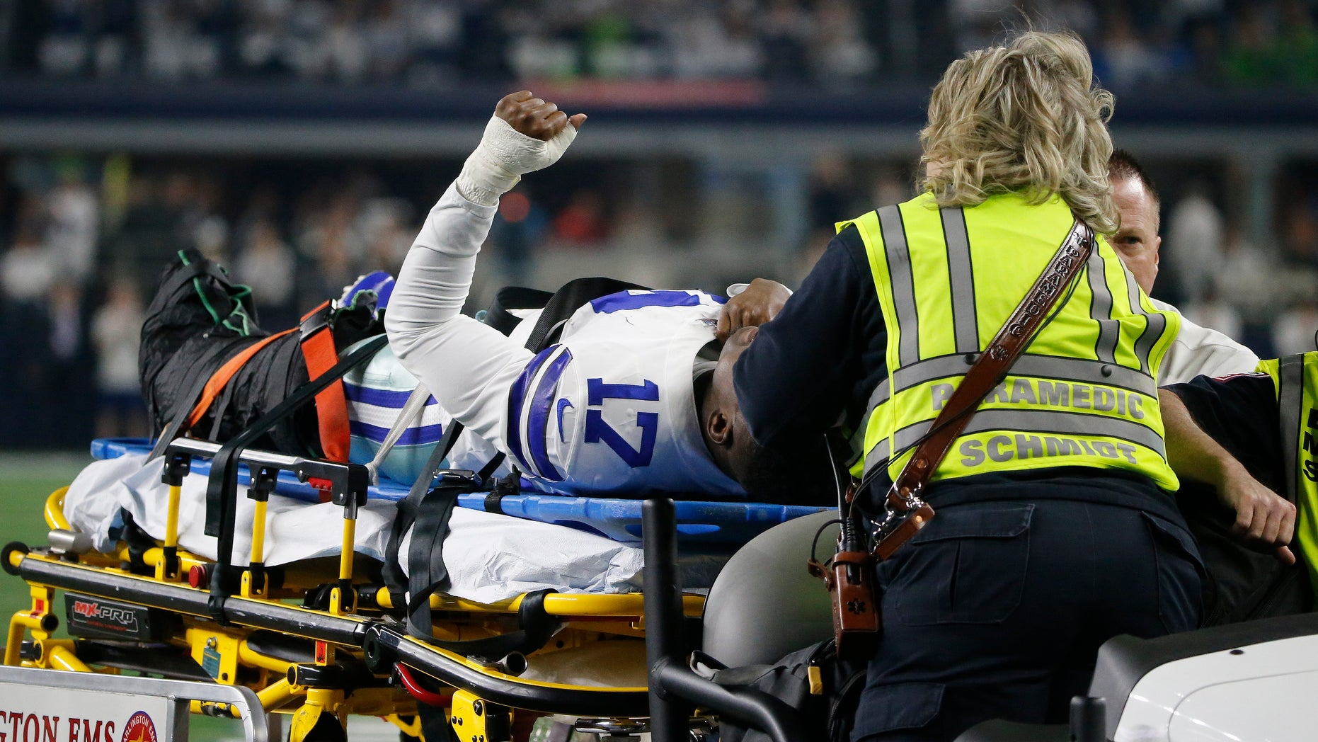 Dallas Cowboys wide receiver Allen Hurns (17) is taken from the field after an injury against the Seattle Seahawks during the first half of the NFC wild-card NFL football game in Arlington, Texas, Saturday, Jan. 5, 2019. (AP Photo/Michael Ainsworth)