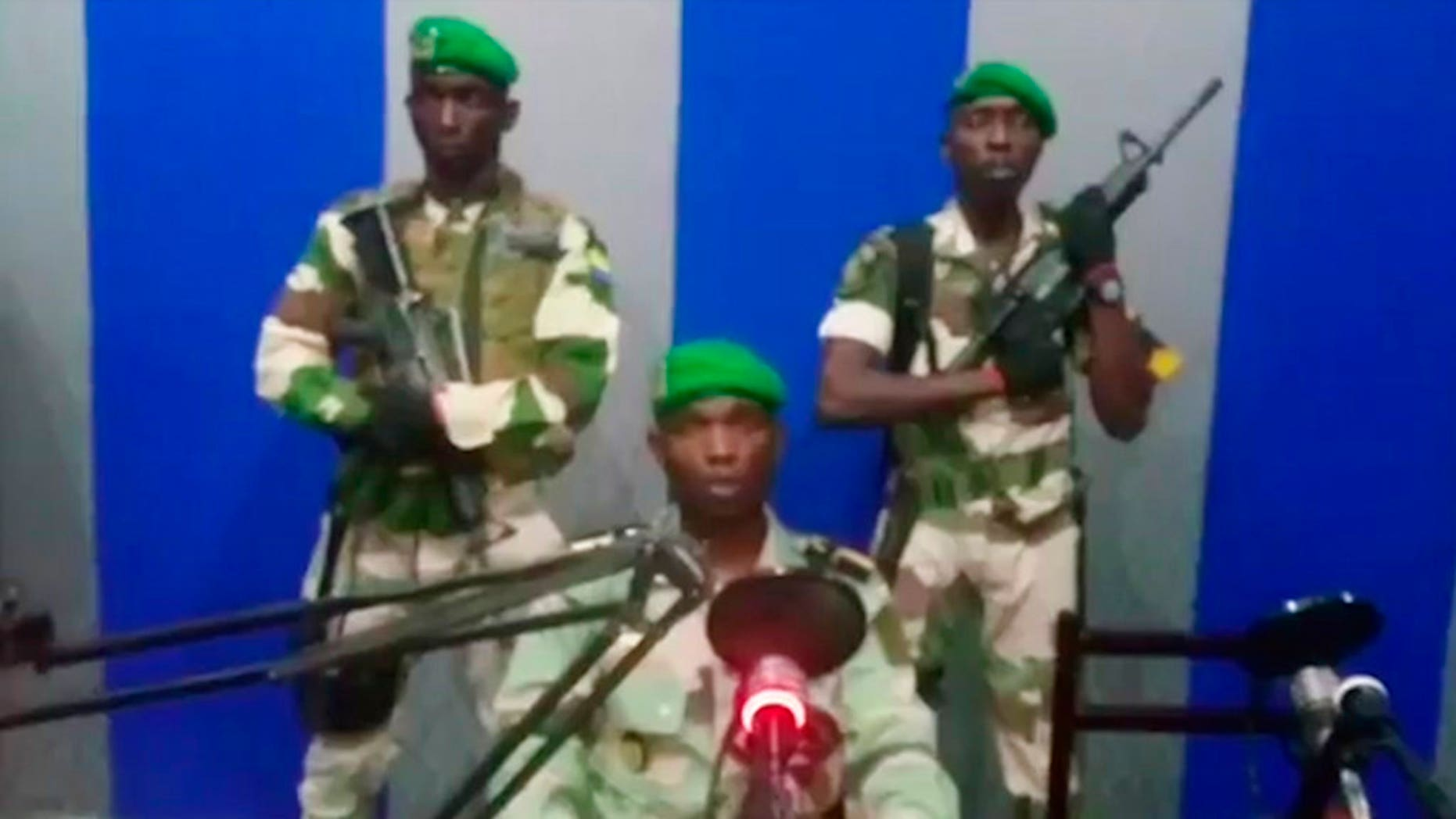 A soldier who identified himself as Lt. Obiang Ondo Kelly, commander of the Republican Guard, reads a statement on state television broadcast from Libreville, saying the military has seized control of the government. (