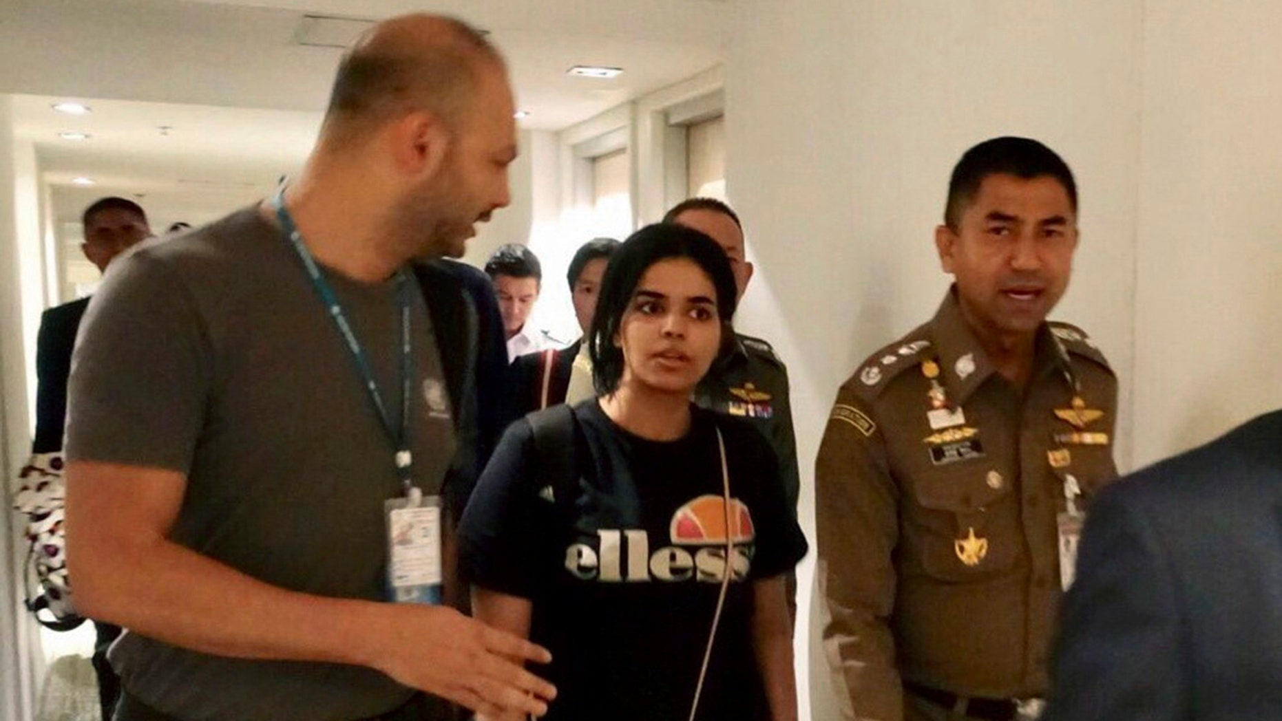 Saudi woman Rahaf Mohammed Alqunun moments before leaving the Suvarnabhumi Airport in Bangkok Monday. The 18-year-old began posting on Twitter late Saturday after her passport was taken away when she arrived on a flight from Kuwait. (Immigration police via AP)