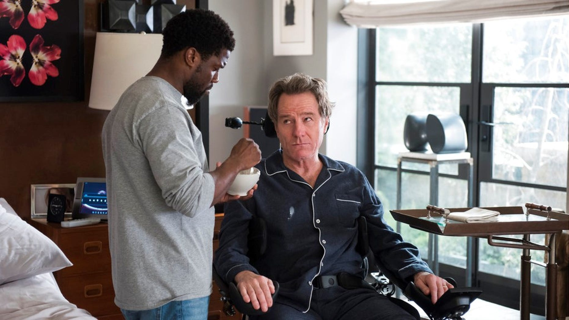 "Bryan Cranston defended playing a man with disabilities in the new movie ""The Upside."""