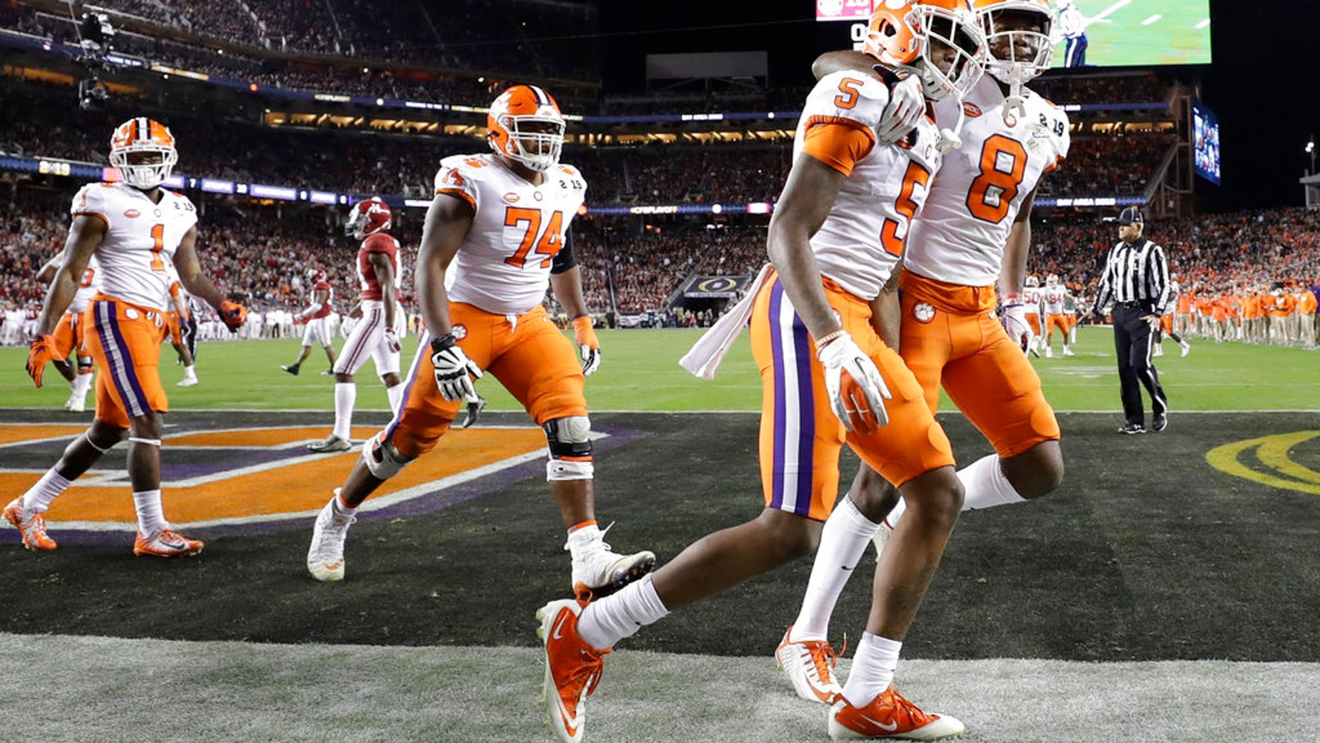 Clemson's Tee Higgins (5) celebrates his touchdown catch during the second half of the NCAA college football playoff championship game against Alabama, Monday, Jan. 7, 2019, in Santa Clara, Calif. (AP Photo/David J. Phillip)