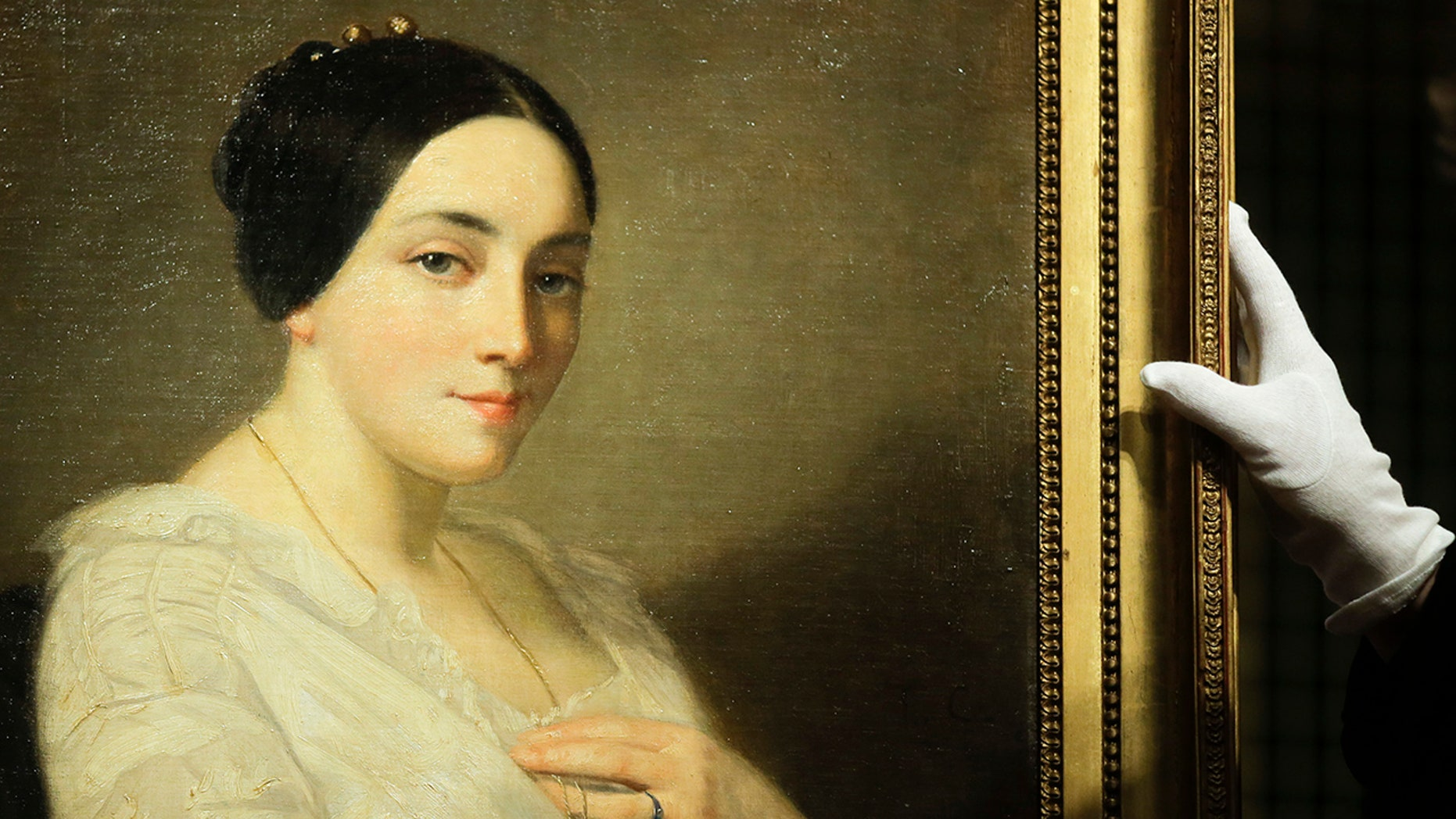 The painting 'Portrait of a Seated Young Woman' by Thomas Couture was discovered in the art trove of late collector Cornelius Gurlitt and belonged to Georges Mandel, a Jewish French politician, and resistance figure who was executed during World War II. (AP Photo/Markus Schreiber)