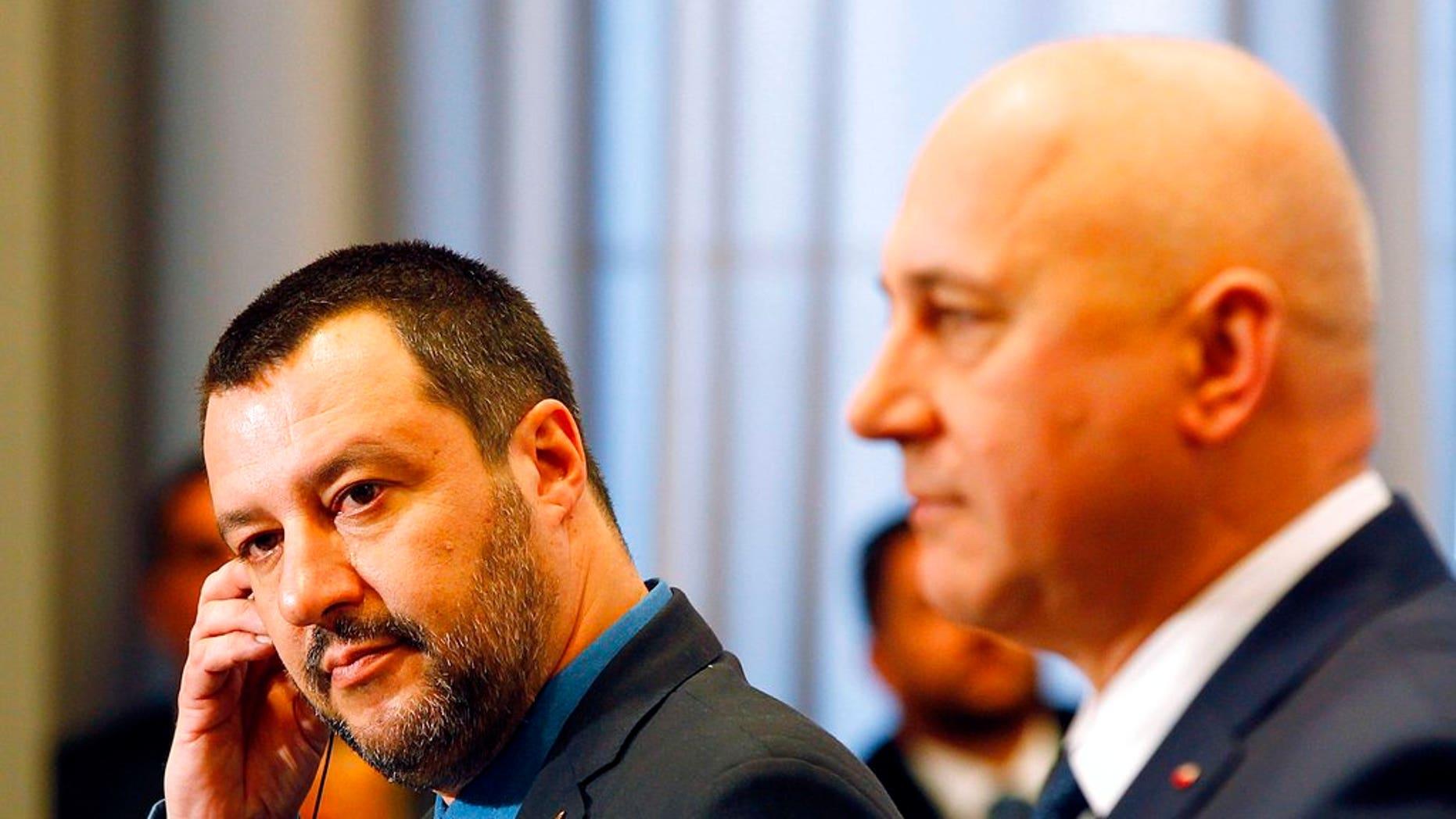 Italian Interior Minister Matteo Salvini, left, and his Polish counterpart Joachim Brudzinski, right, address the media following their talks in Warsaw, Poland, Wednesday, Jan. 9, 2019.